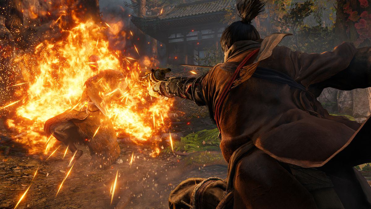 Sekiro sets a monk on fire in a screenshot from Sekiro: Shadows Die Twice.