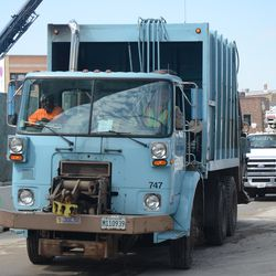10:47 a.m. City garbage truck and ComEd truck make their way down Waveland -