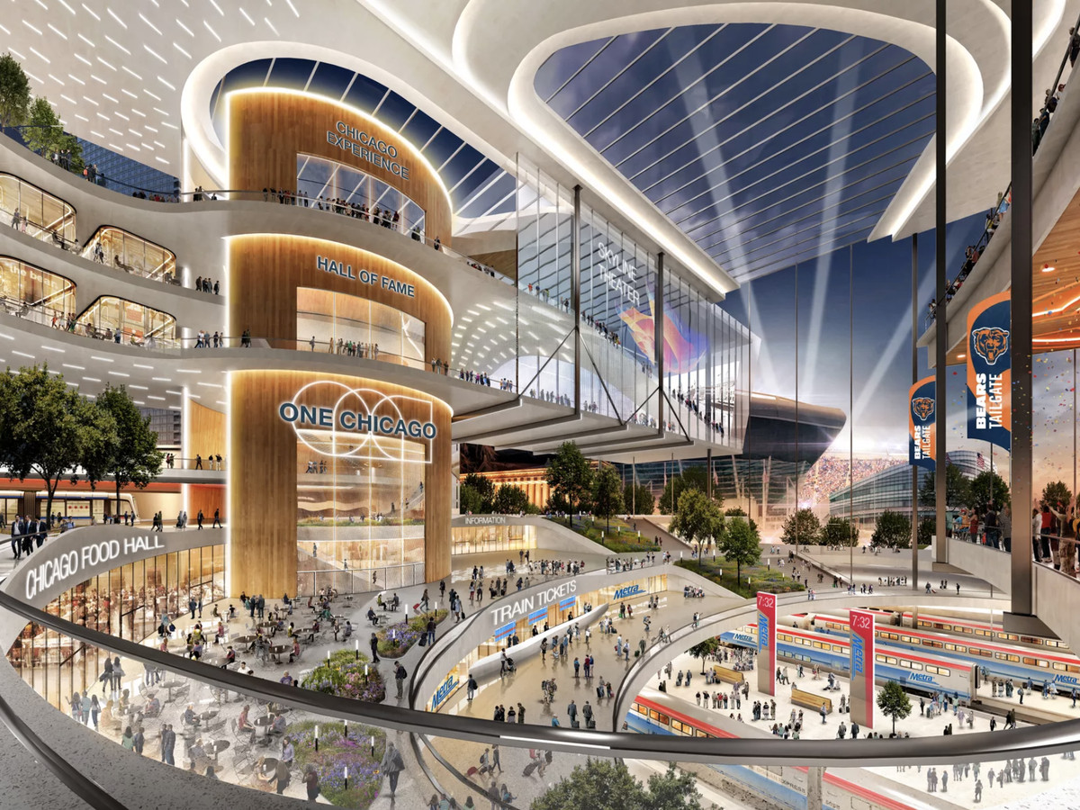 A rendering of the One Central transit hub showing a large multi-level atrium lined with shops and other attractions overlooking train platforms below.