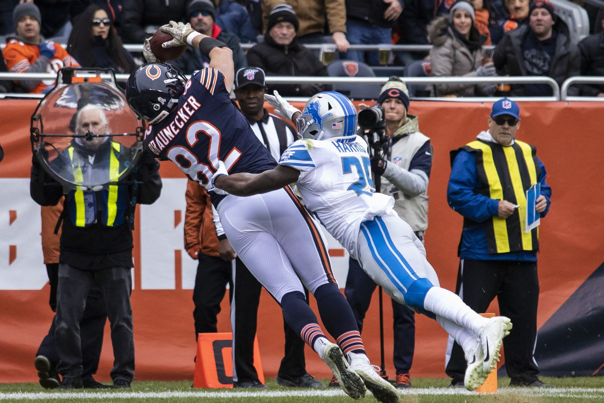 Bears tight end Ben Braunecker (82) makes a reaching grab against good coverage from Lions safety Will Harris for an 18-yard touchdown pass with 25 seconds left in the first half that gave the Bears a 7-6 lead.  The Bears won, 20-13 on Sunday at Soldier Field.