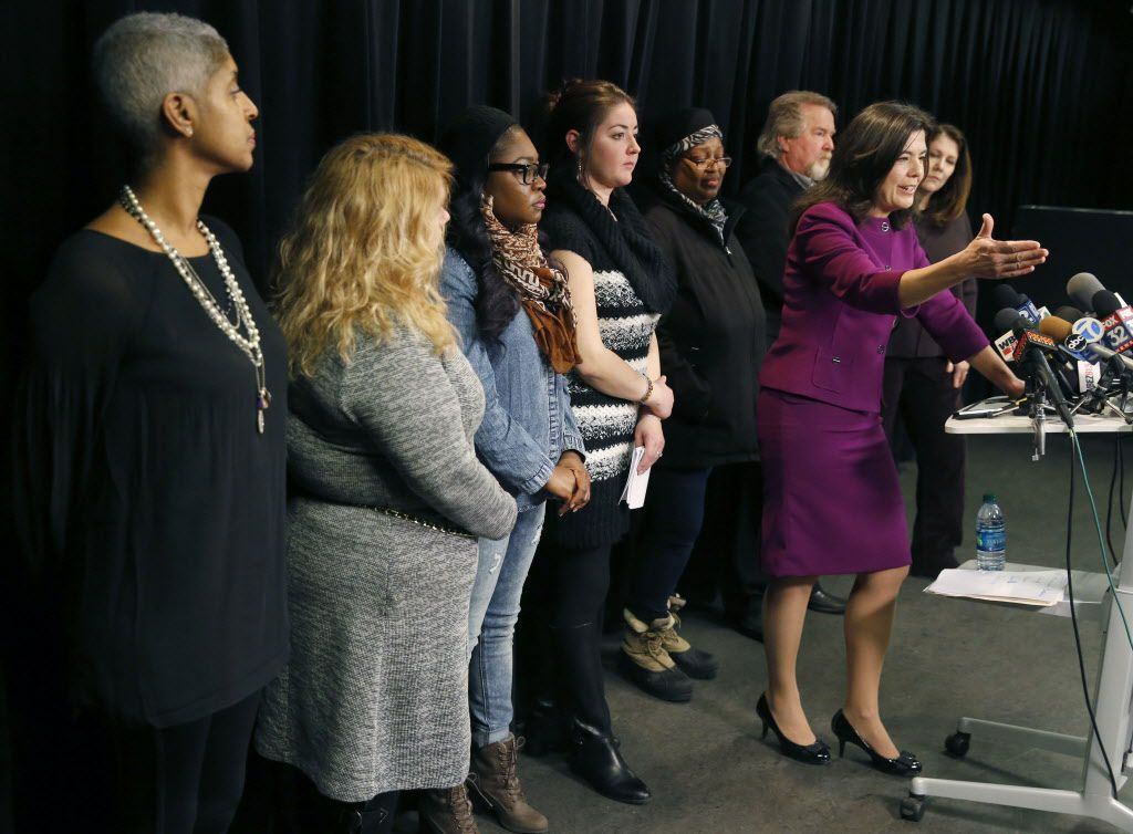 Cook County State's Attorney Anita Alvarez, right, responds to a question about her re-election bid during a news conference with victims of violent crimes Thursday, Jan. 14, 2016, in Chicago. (AP Photo/Charles Rex Arbogast)