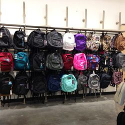 Jansport backpacks in various prints and hues.