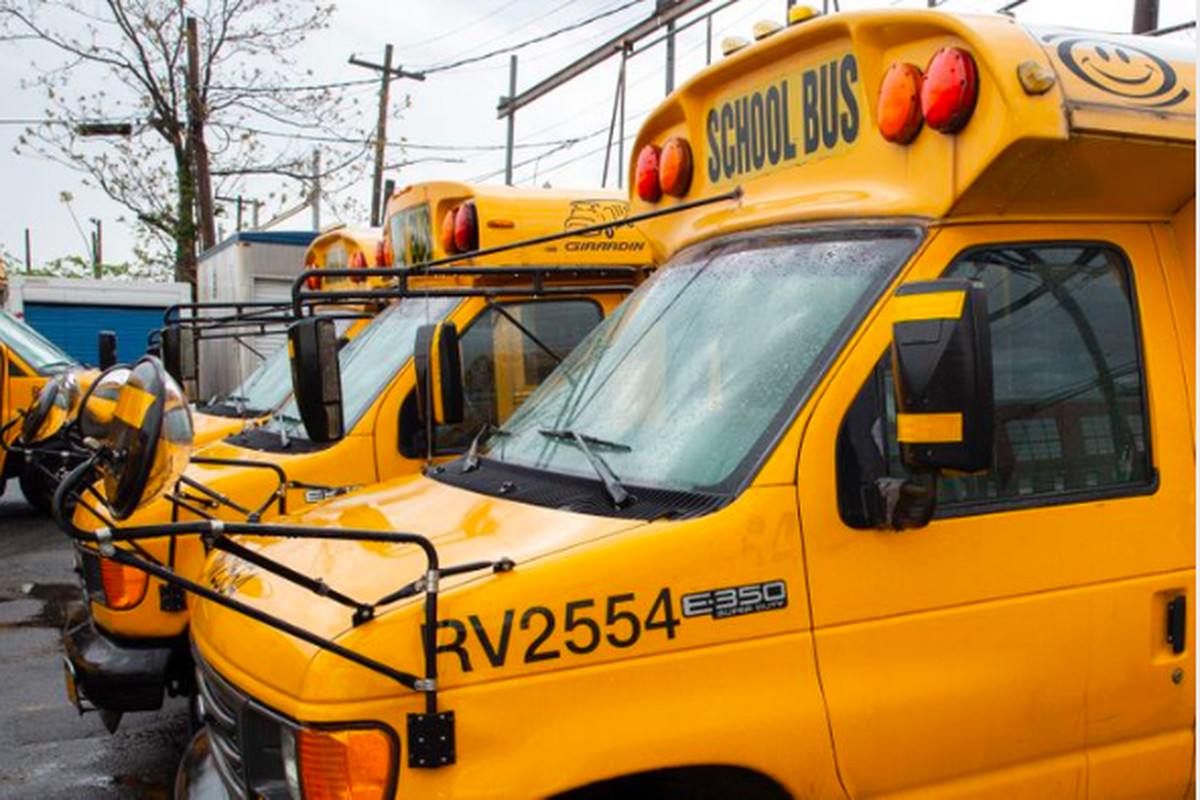Yellow school buses parked in a Brooklyn depot in April.