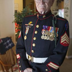 Eighty-seven-year-old retired Marine John Cole, who served and was wounded in North Korea, poses for a portrait at his home in Roy Wednesday, Feb. 18, 2015.