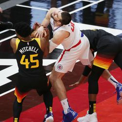 Utah Jazz guard Donovan Mitchell (45) ties up LA Clippers center Ivica Zubac (40) during the NBA playoffs in Salt Lake City on Thursday, June 10, 2021. The Jazz won 117-111.