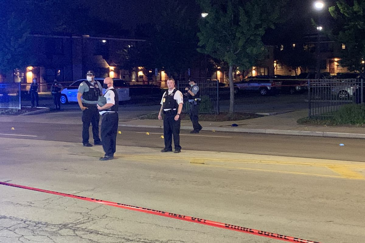 Police investigate a scene where two teen boys and a 5-year-old girl were shot in a drive-by May 26, 2020, in Wentworth Gardens.