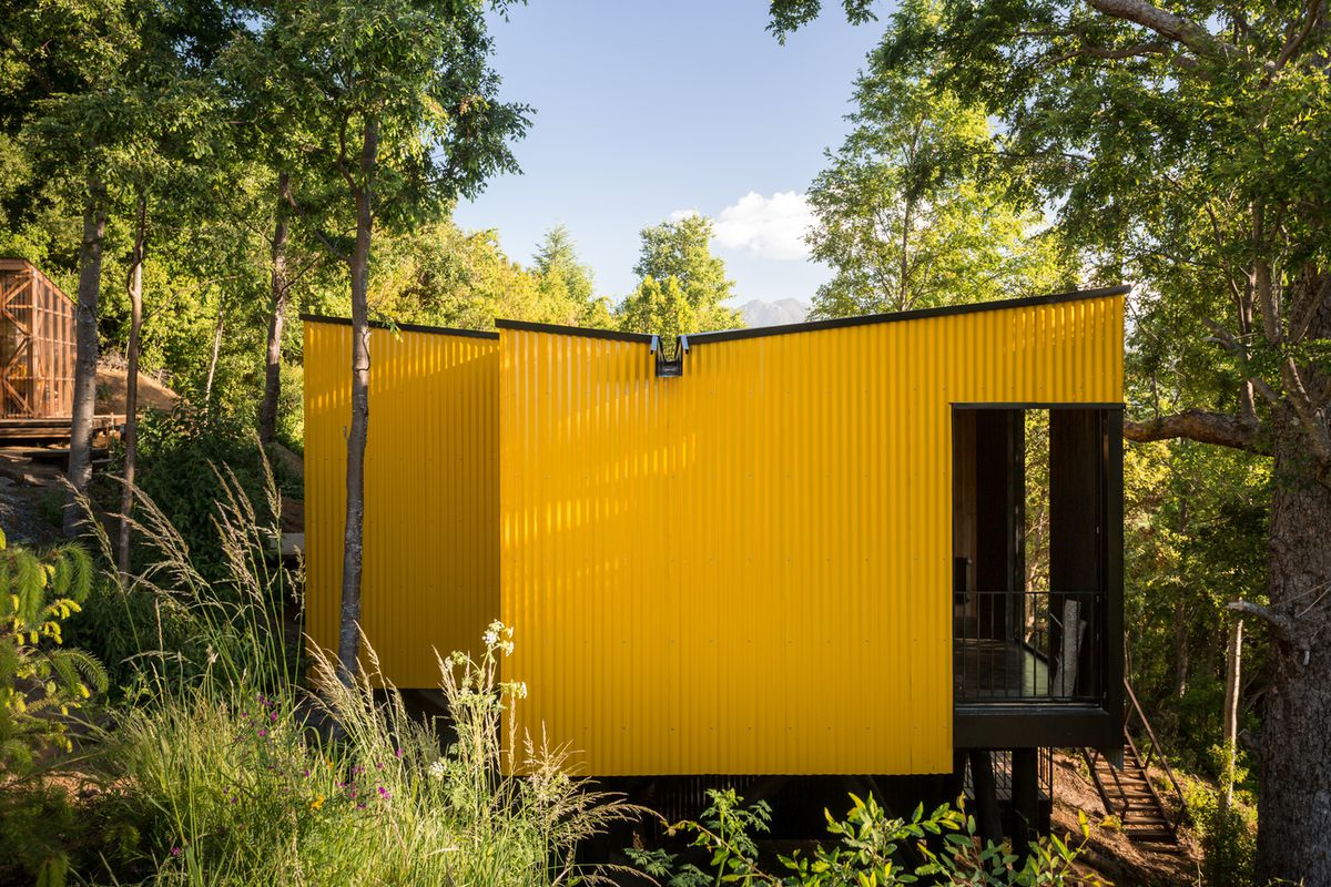 Yellow house surrounded by greenery