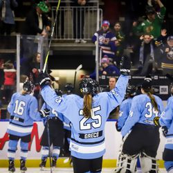Beauts celebrate as they leave the ice.