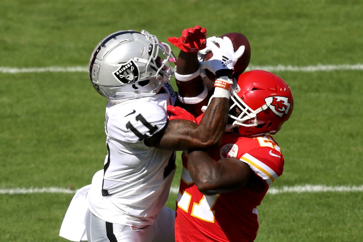Henry Ruggs III #11 of the Las Vegas Raiders catches a 46-yard pass against Rashad Fenton #27 of the Kansas City Chiefs during the first quarter at Arrowhead Stadium on October 11, 2020 in Kansas City, Missouri.