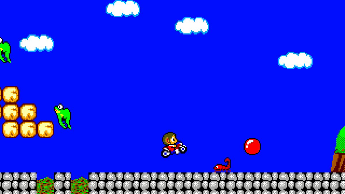 Alex Kidd in Miracle World DX's classic graphics mode with Alex on his motorbike