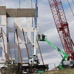 Construction crews work on a new commercial building in Lehi on Wednesday, March 23, 2016. Salt Lake County's population of 1.1 million is almost double that of Utah County, the state's next most populous county. But Utah County could soon be gaining a larger number of people each year than its neighbor to the north thanks to a thriving tech industry and overall economic opportunity that bring in a steady stream of new residents.