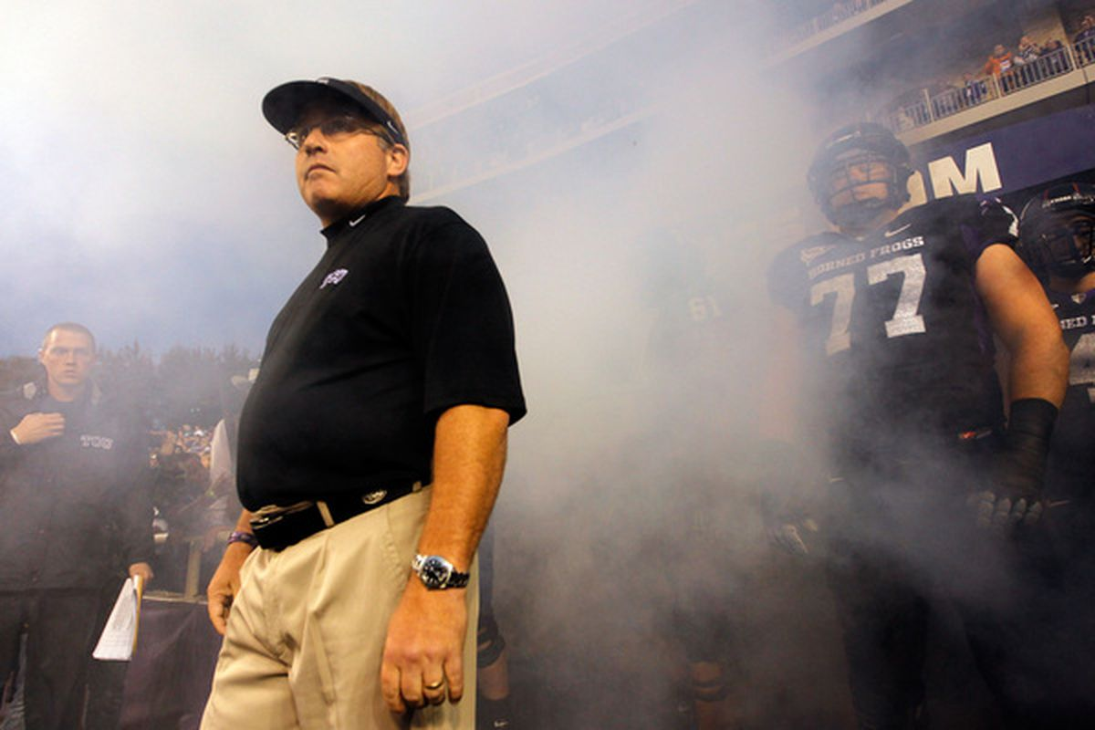 FORT WORTH TX - OCTOBER 23:  Head coach Gary Patterson of the TCU Horned Frogs leads his team on the field against the Air Force Falcons at Amon G. Carter Stadium on October 23 2010 in Fort Worth Texas.  (Photo by Tom Pennington/Getty Images)