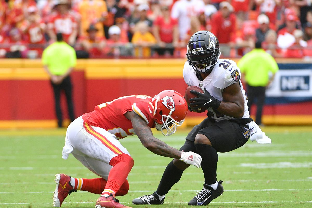 Baltimore Ravens running back Mark Ingram runs the ball and is tackled by Kansas City Chiefs defensive back Bashaud Breeland during the second half at Arrowhead Stadium.