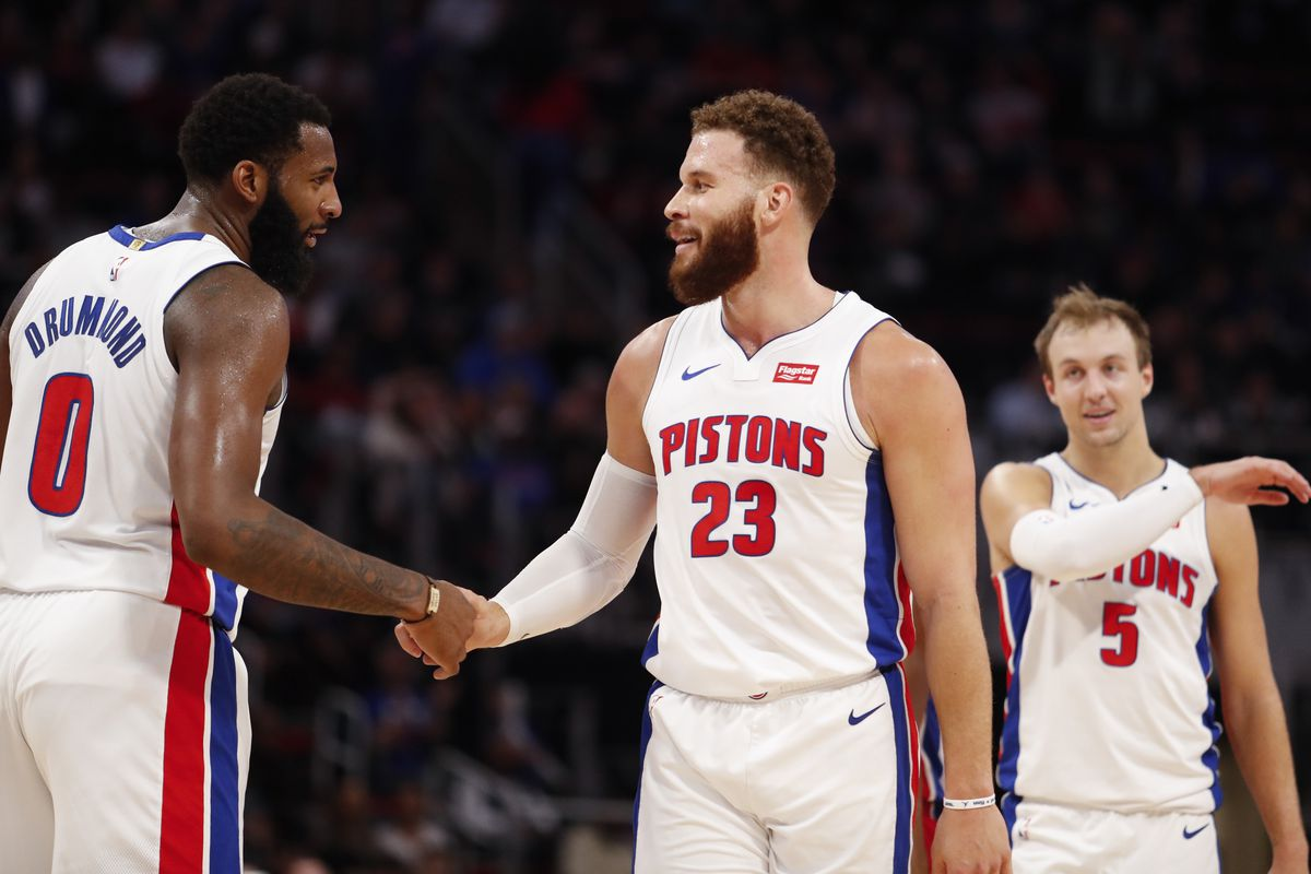 Detroit Pistons forward Blake Griffin shakes hands with center Andre Drummond during the fourth quarter against the Minnesota Timberwolves at Little Caesars Arena.