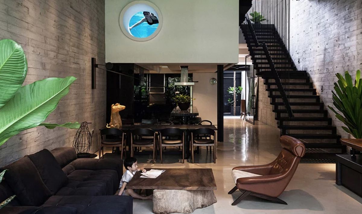 Living room with portal hole looking in from pool