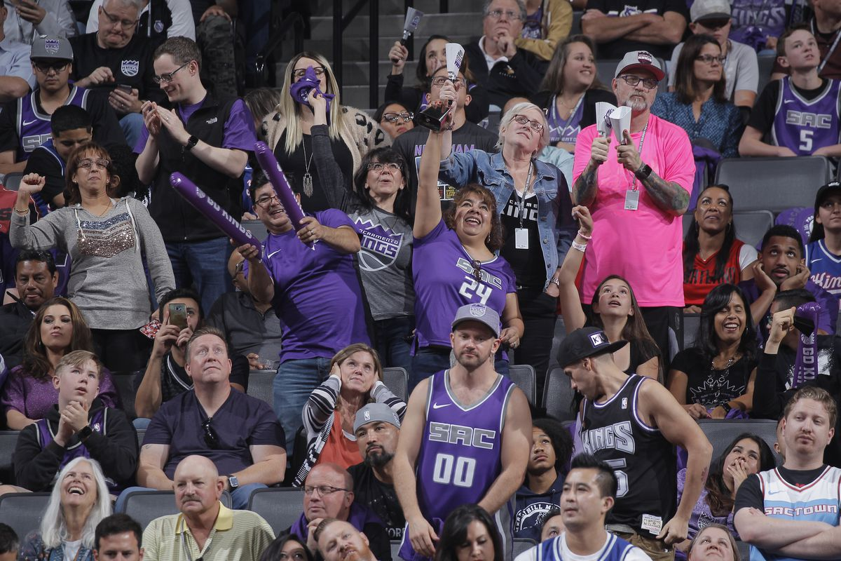 SACRAMENTO, CA - OCTOBER 25: Fans cheer on the Sacramento Kings with cowbells during the game against the Portland Trail Blazers on October 25, 2019 at Golden 1 Center in Sacramento, California.