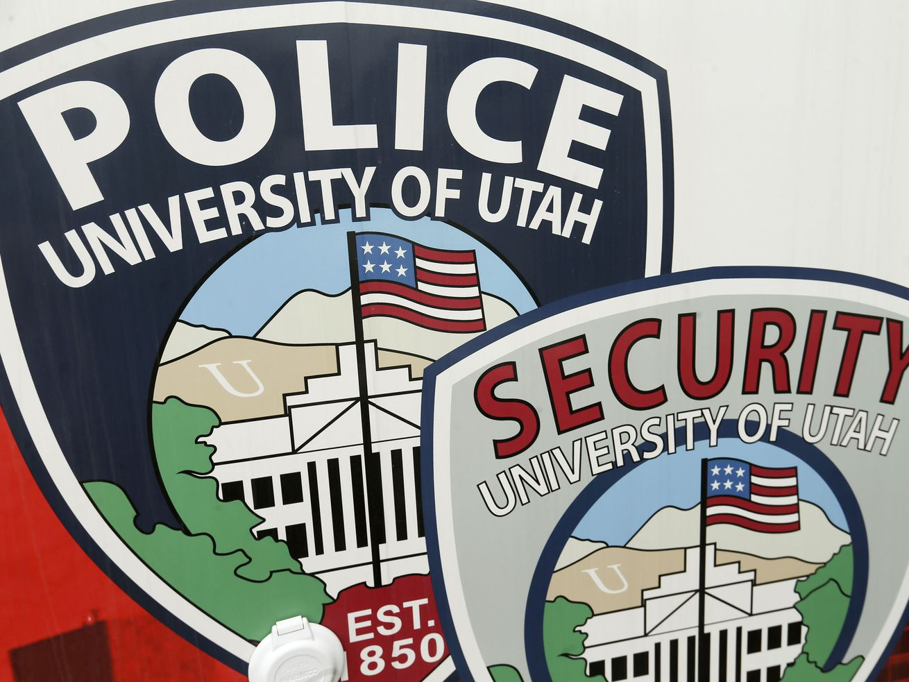 Police and security services emblems are pictured at the University of Utah in Salt Lake City on Friday, April 16, 2021.