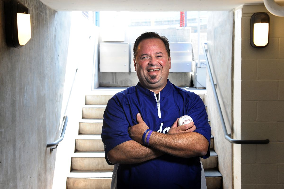 Dodgers clubhouse manager Mitch Poole stands in the tunnel near the dugout at dodger Stadium. Poole