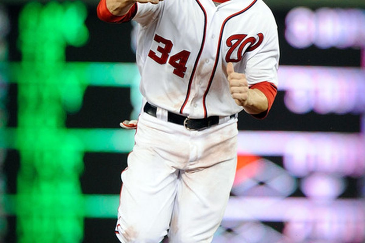 WASHINGTON, DC - MAY 04:  Bryce Harper #34 of the Washington Nationals celebrates after a 4-3 victory against the Philadelphia Phillies at Nationals Park on May 4, 2012 in Washington, DC.  (Photo by Greg Fiume/Getty Images)