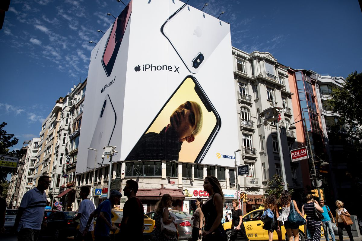 A billboard ad for iPhone X on a busy street in Istanbul