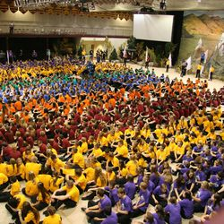 """Some 1,200 youths of the new Star Valley Wyoming Temple District gather in their stake """"colors"""" on the floor of the gymnasium prior to a performance of a cultural celebration held in conjunction with dedicatory events for the new edifice."""
