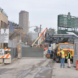 The construction fence remains standing along the curb to the original gate location -