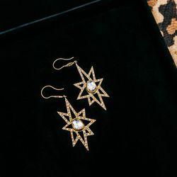 <b>Annie Fensterstock</b> yellow gold diamond earrings, $8,500.