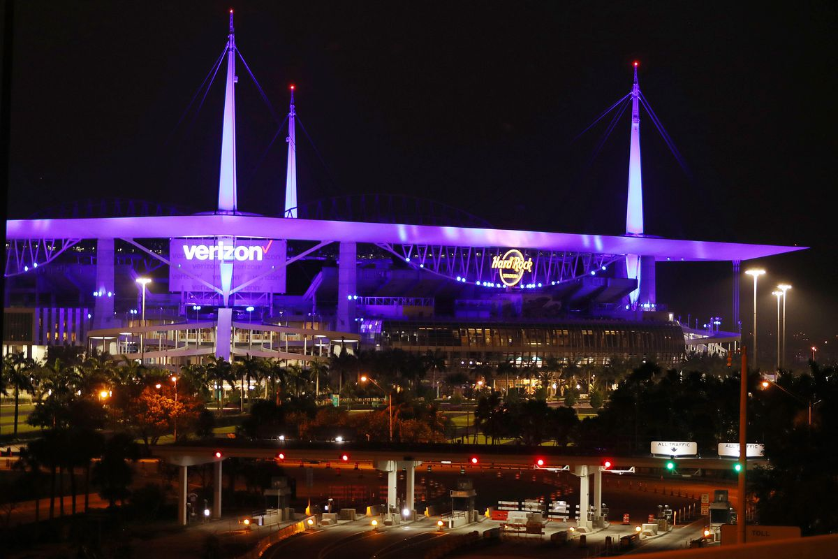 Hard Rock Stadium is lit in blue to honor health care workers and first responders.