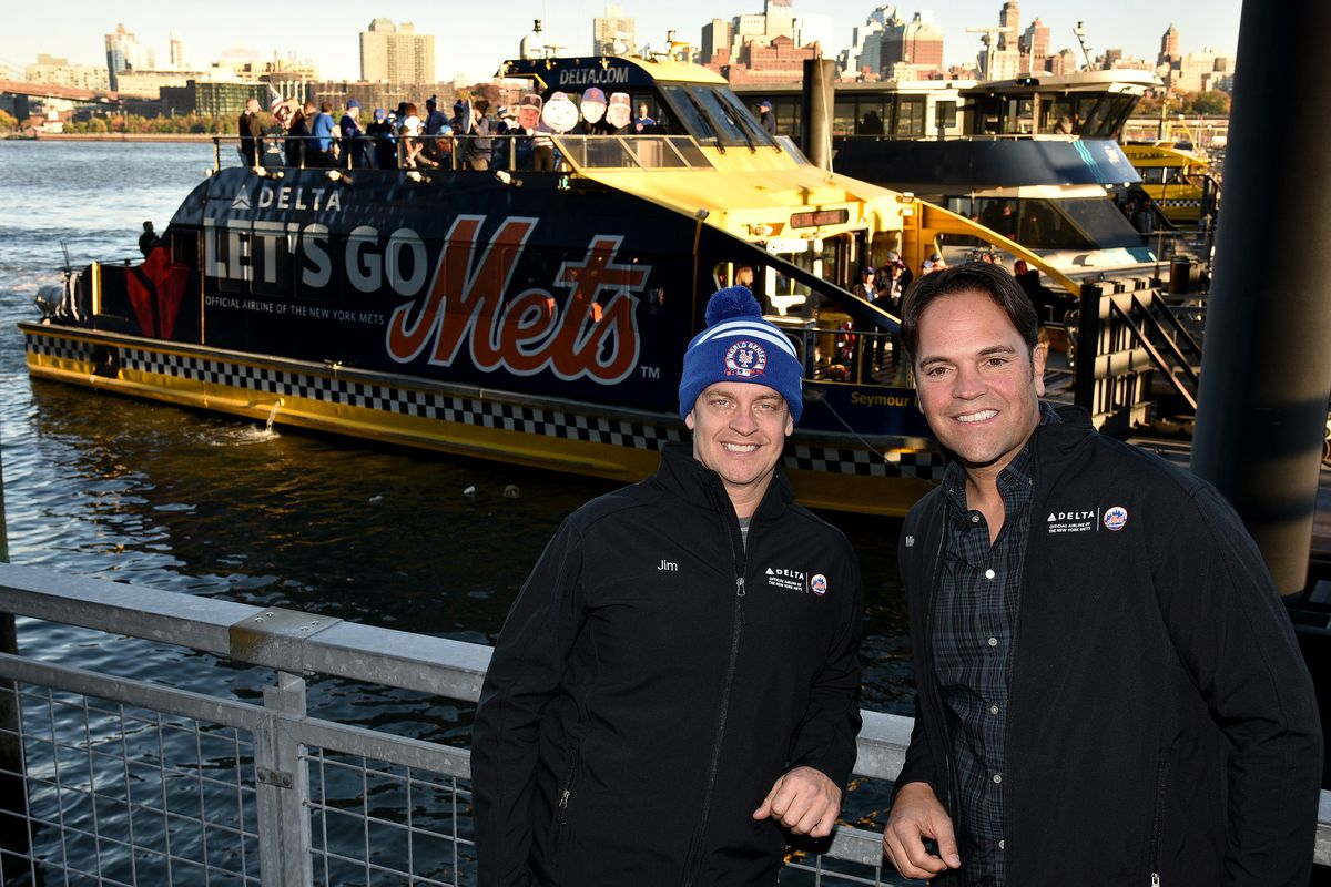 Jim Breuer and Mike Piazza in front of the Amazin' Mets Express.