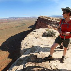 Interior Secretary Sally Jewell stands on Comb Ridge as she visits rock art sites, some of witch have been vandalized in southern Utah on Saturday, July 16, 2016.