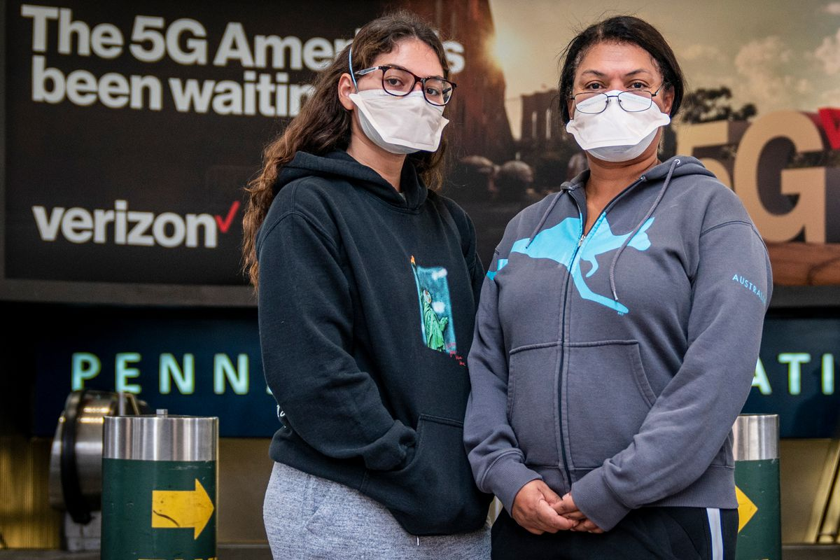 Isabella Green and her mother, Marise Santo, wait to vote at Madison Square Garden in Manhattan Saturday morning, Oct. 24, 2020.