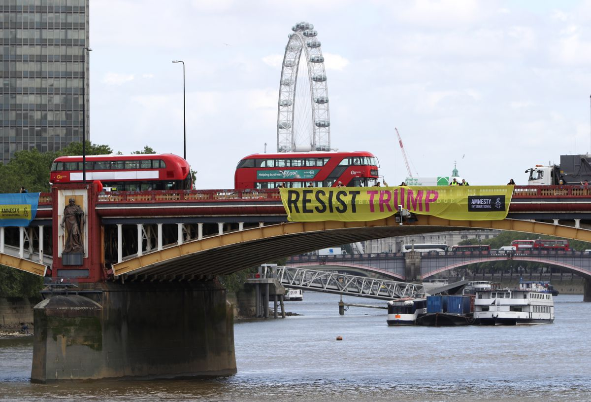 "Amnesty International installed ""Resist Trump"" banners on Vauxhall Bridge following the arrival of President Donald Trump on June 3, 2019, in London, England."