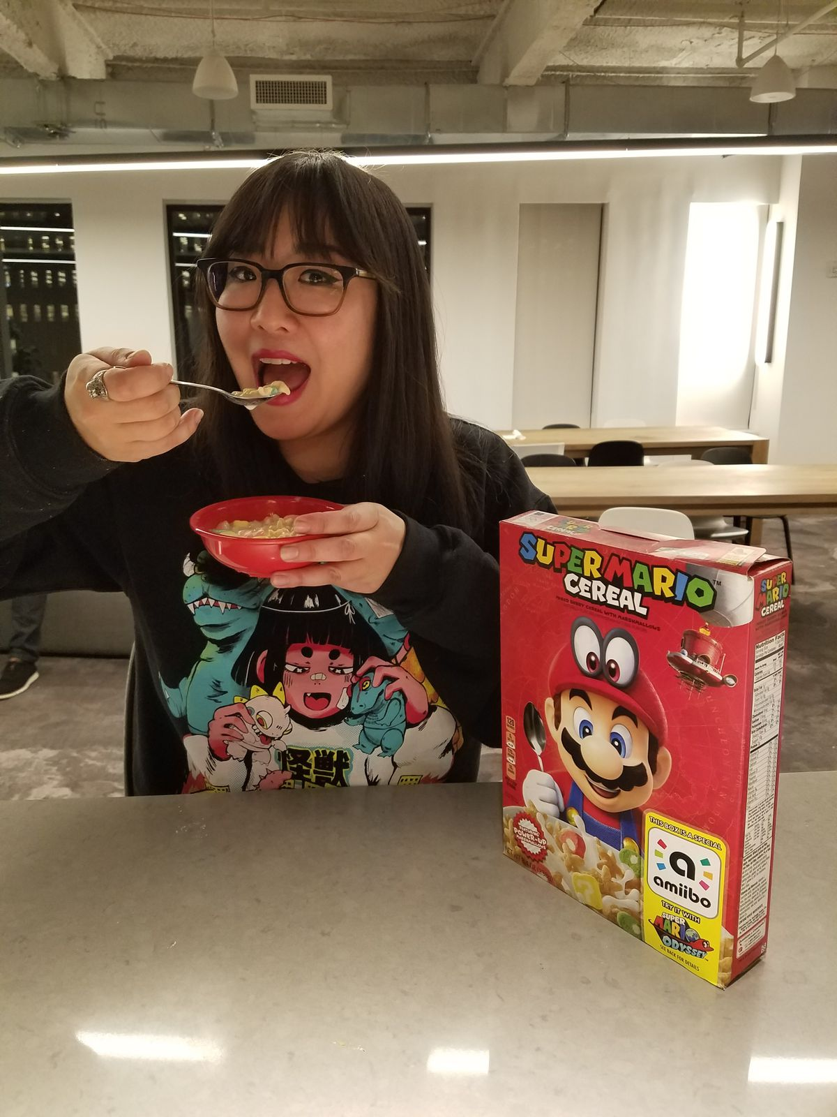 Ashley Oh goes in for her first taste of Mario Cereal.