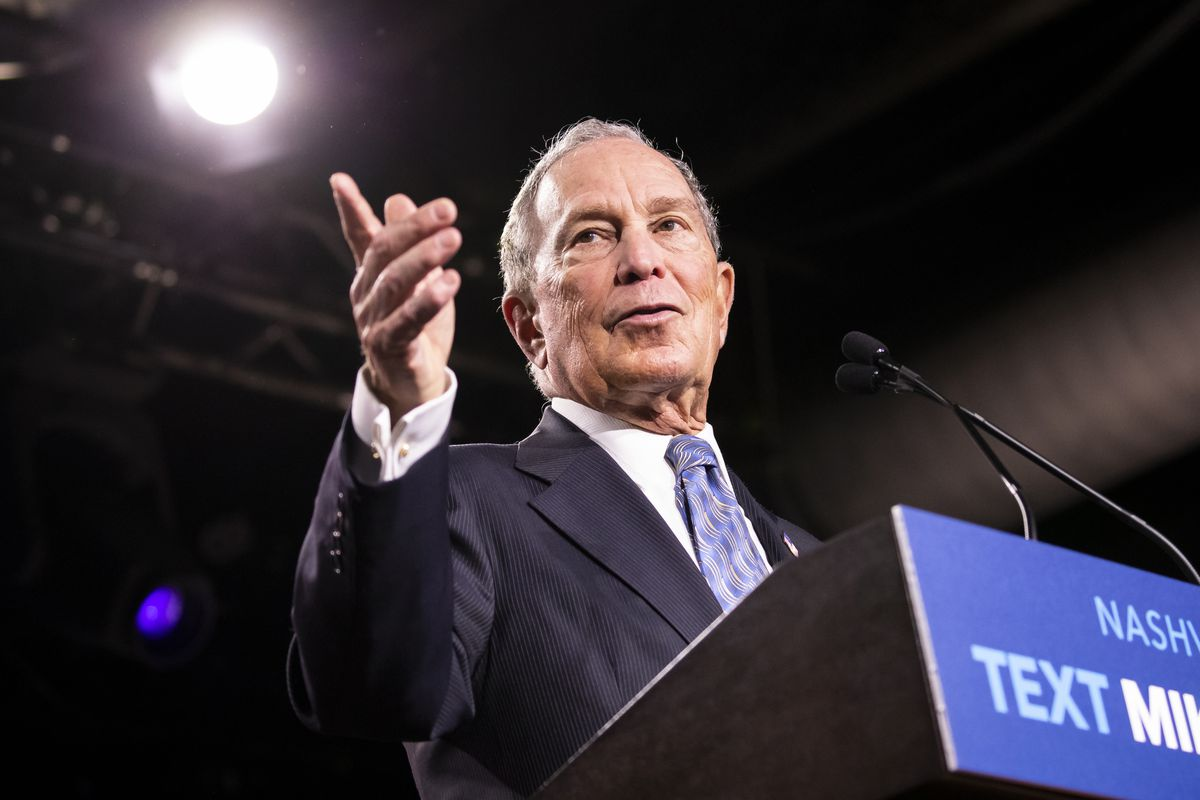 Mike Bloomberg speaking from a podium on the campaign trail.