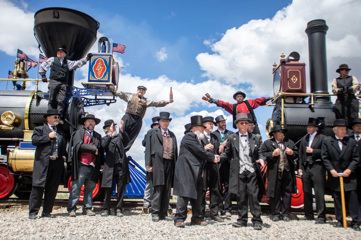"""The """"champagne photo"""" is re-created during a celebration marking the 152nd anniversary of the completion of the nation's first transcontinental railroad at Golden Spike National Historic Park near Corrine, Box Elder County, on Monday, May 10, 2021."""