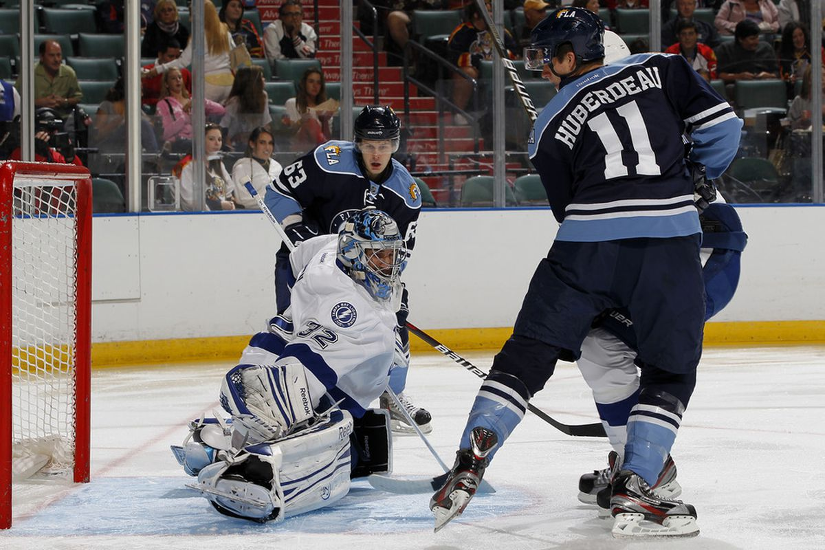 Goaltender Mathieu Garon #32 of the Tampa Bay Lightning stops a shot by Jonathan Huberdeau of the Florida Panthers on September 24, 2011 at the BankAtlantic Center in Sunrise, Florida.