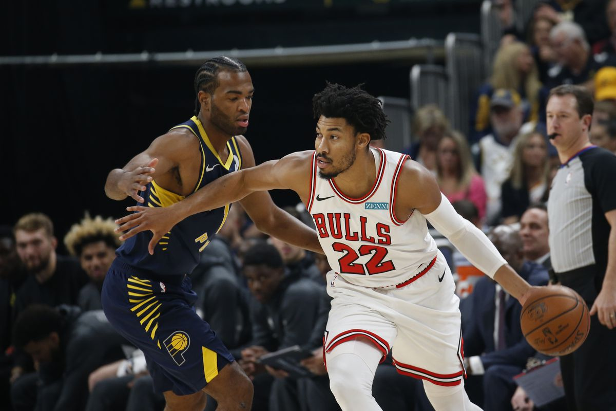 Chicago Bulls forward Otto Porter Jr. is guarded by Indiana Pacers forward T.J. Warren during the first quarter at Bankers Life Fieldhouse.