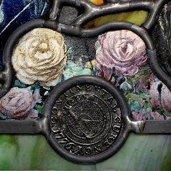 """A coin is embedded in a section of """"Roots of Knowledge"""" at Holdman Studios at Thanksgiving Point in Lehi on Friday, Sept. 16, 2016. A Guardian UK reporter called the work """"one of the most spectacular stained glass windows made in the past century."""""""