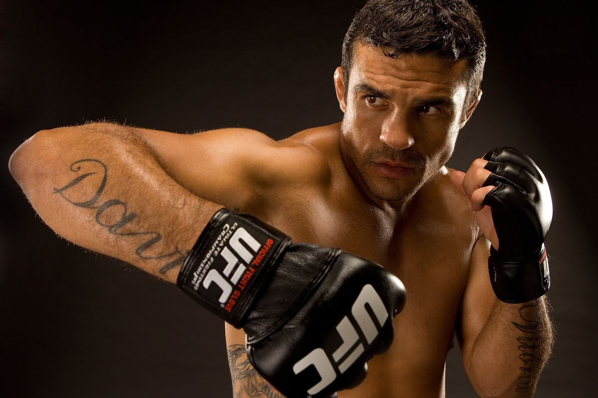 Vitor Belfort is favored to knockout Evander Holyfieldin their boxing match