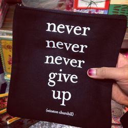 """Shopping around Soho for stationary (a guilty pleasure of mine) and I stumble on this inspirational pouch at <a href=""""http://www.paper-source.com/""""><b>The Paper Source</b></a> with a quote by Winston Churchill. """"Never, never, never, never give up,"""" it say"""