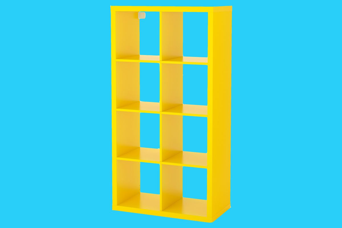 Yellow shelving unit made up of cubbies arranged in a 2x4 grid on a blue background.