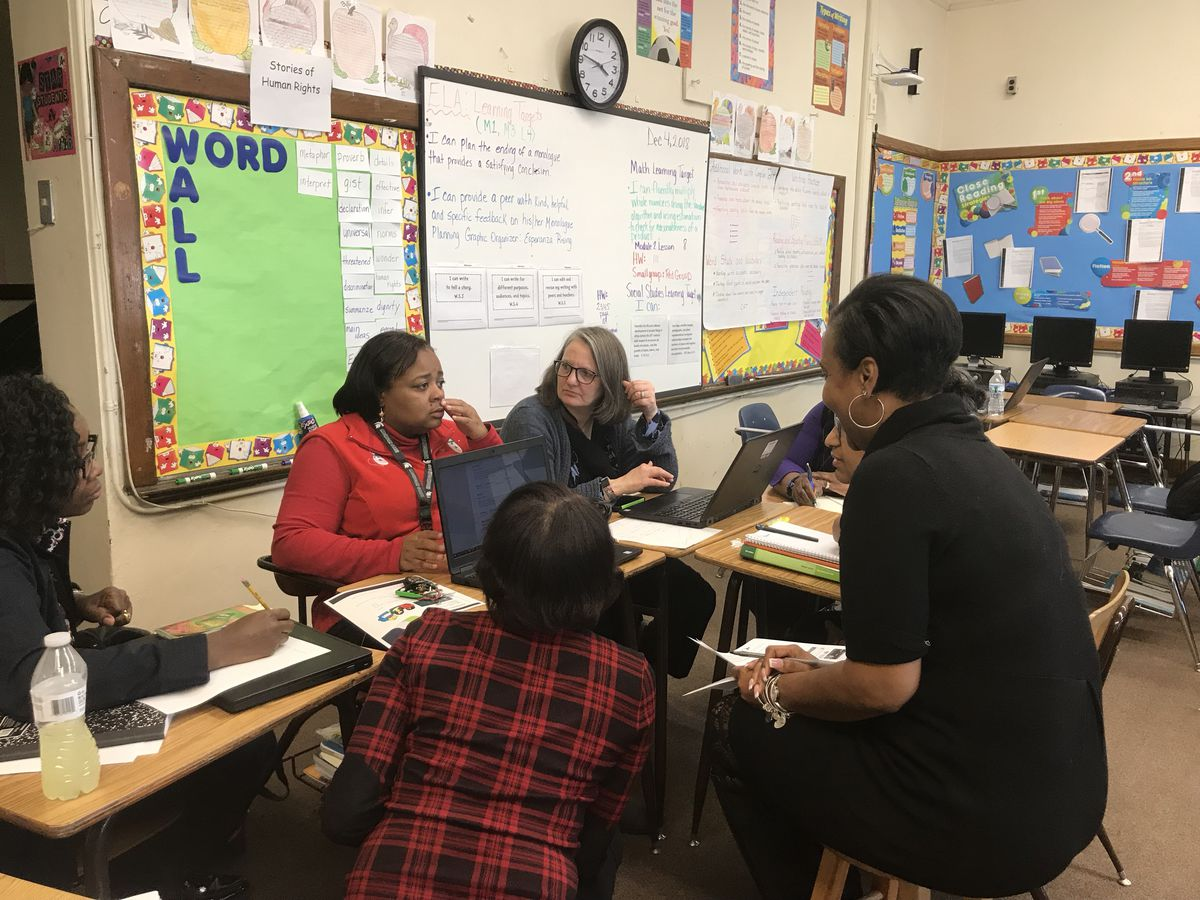At Davison Elementary School, teachers get together on a regular basis to share ideas and get help with the Detroit school district's new curriculum.