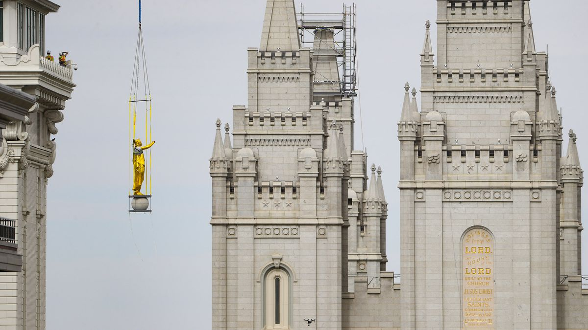 A crane lowers the statue of the Angel Moronifrom atop The Church of Jesus Christ of Latter-day Saints' Salt Lake Temple in Salt Lake City on Monday, May 18, 2020. The statue lost its trumpet during an earthquake on March 18. The temple is currently undergoing renovation.