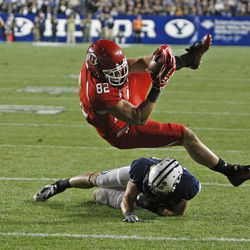 Utah Utes tight end Jake Murphy (82) scores a touchdown over Brigham Young Cougars linebacker Kyle Van Noy (3)as the University of Utah and Brigham Young University play football Saturday, Sept. 17, 2011, in Provo, Utah.