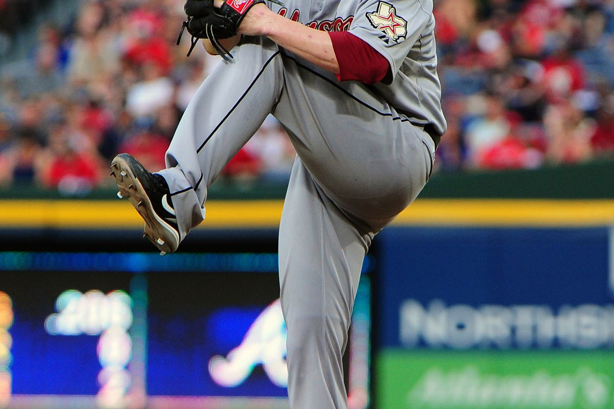 ATLANTA, GA - AUGUST 4: Lucas Harrell #64 of the Houston Astros pitches against the Atlanta Braves at Turner Field on August 4, 2012 in Atlanta, Georgia. (Photo by Scott Cunningham/Getty Images)