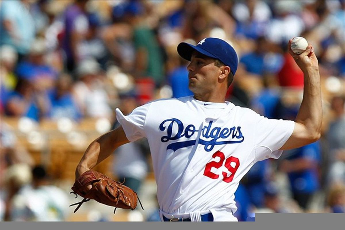 Mar. 11, 2012; Phoenix, AZ, USA; Los Angeles Dodgers starting pitcher Ted Lilly (29) pitches during the first inning against the Chicago Cubs at Camelback Ranch. Dodgers won 5-0. Mandatory Credit: Debby Wong-US PRESSWIRE