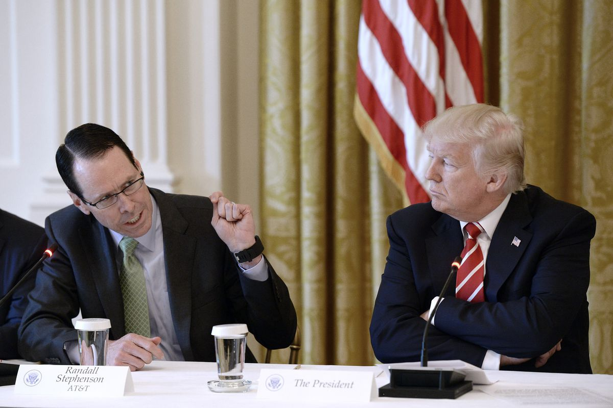 AT&T CEO Randall Stephenson and President Donald Trump at the White House in June 2017. Trump was critical of AT&T's bid to acquire Time Warner, and Stephenson made multiple efforts to appease him and lessen his animus.