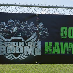 Legion of Boom banner at the camp. Chris Maragos is second from the right.