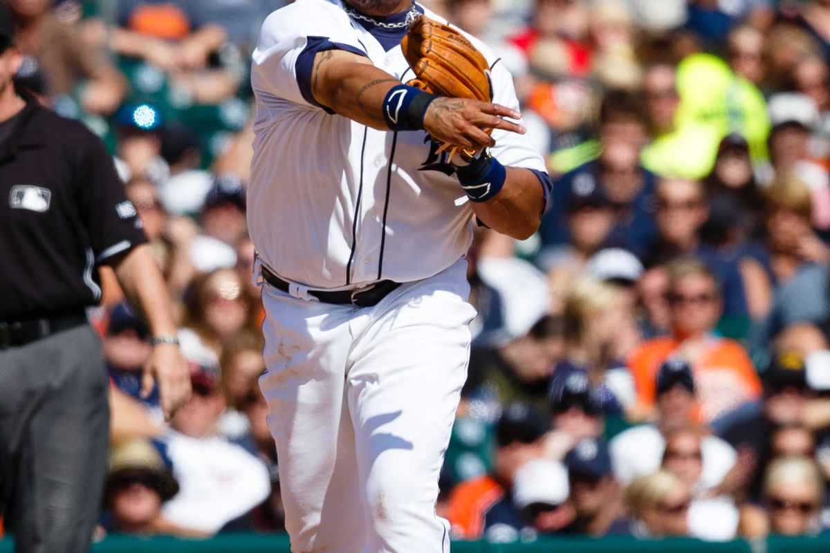 August 19, 2012; Detroit, MI, USA; Detroit Tigers third baseman Miguel Cabrera (24) makes a throw to first during the eighth inning against the Baltimore Orioles at Comerica Park. Baltimore won 7-5. Mandatory Credit: Rick Osentoski-US PRESSWIRE