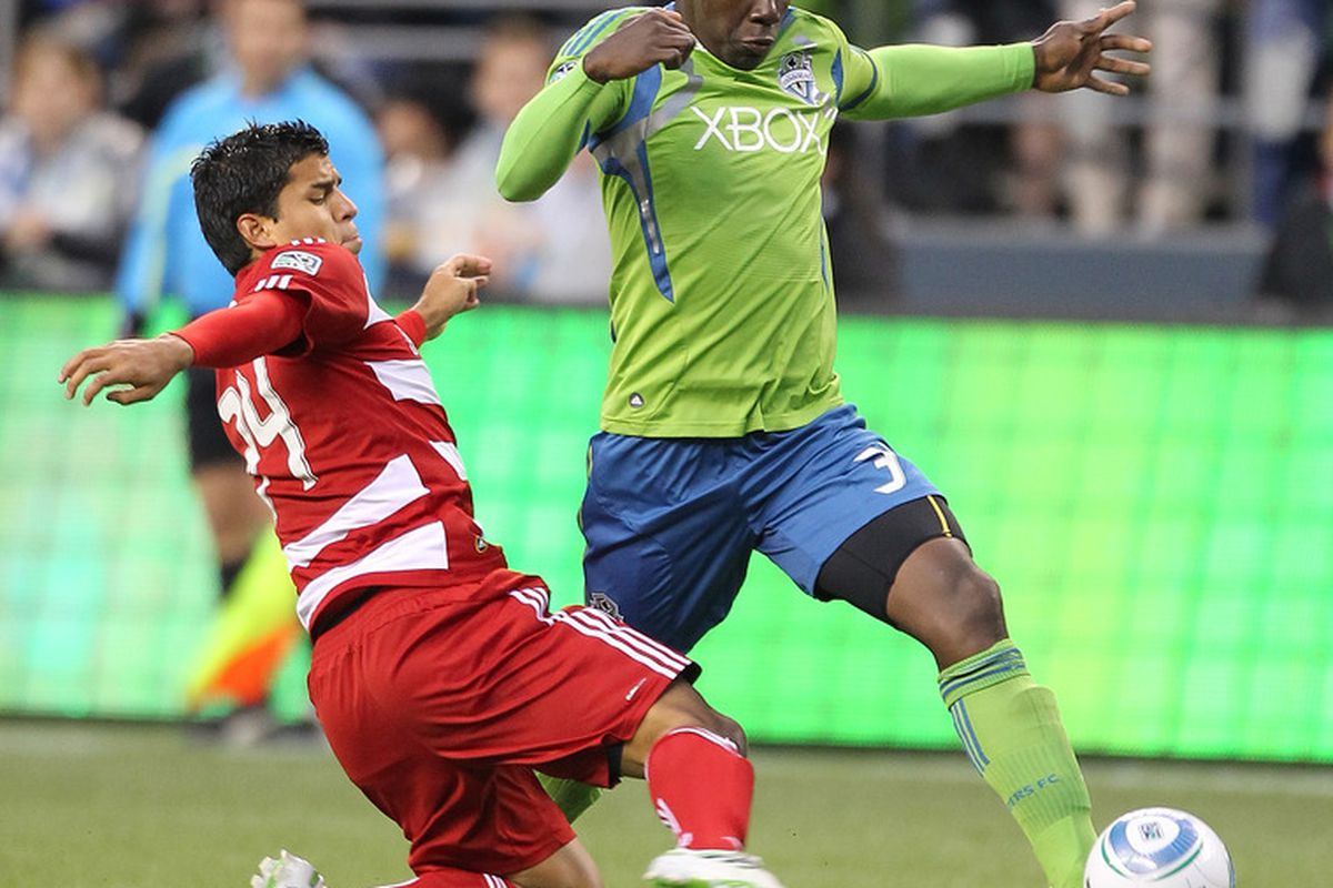 SEATTLE - MAY 25:  Jhon Kennedy Hurtado #34 of the Seattle Sounders FC dribbles against Ruben Luna #34 of FC Dallas at Qwest Field on May 25, 2011 in Seattle, Washington. FC Dallas defeated the Sounders 1-0. (Photo by Otto Greule Jr/Getty Images)